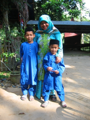 Allo, Hidayat and their mother, Yan, in their best outfits, just before Hari Ryah, their feast to celebrate the end of Ramadan.