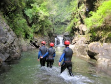 Canyoning often involves hiking through water.